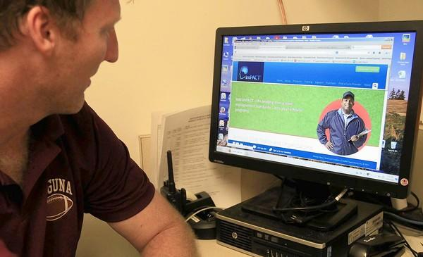 Laguna Beach High School head athletics trainer Ron Holaday demonstrates the department's new concussion monitor system, the ImPACT test.