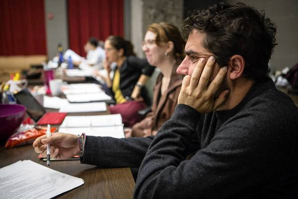 "Director Anne Kauffman (from left), assistant director Beth Lopes and playwright Noah Haidle in rehearsal for ""Smokefall"" at the Goodman Theatre."