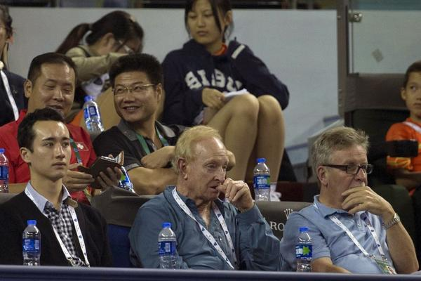 Rod Laver, front center, watches play at the Shanghai Masters.