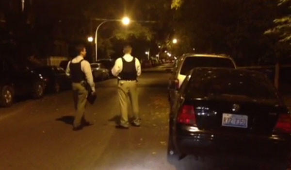 Police at the scene where a 24-year-old man was shot in the 2400 block of South Trumbull Avenue about 9:10 p.m. Oct. 9.