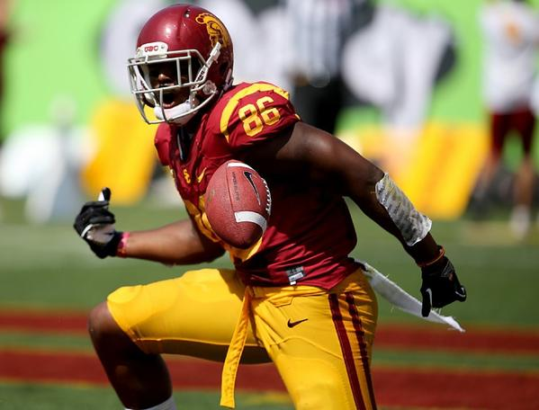USC tight end Xavier Grimble celebrates a touchdown catch and run against Utah State on Sept. 21.
