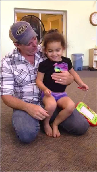 """Matt Capobianco sits with baby Veronica in Tahlequah, Oklahoma, in this handout photo courtesy of the Capobianco Family. The 4-year-old Cherokee girl known as """"Baby Veronica,"""" who is at the center of a cross-country custody battle, was handed back to her adoptive non-Native American family on September 23, 2013, a Cherokee Nation spokeswoman told Reuters. The Oklahoma Supreme Court cleared the way for the girl to be transferred from the custody of her biological father in Oklahoma, Dusten Brown, with whom she has lived for nearly two years."""
