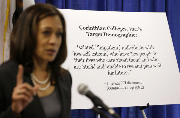 California Atty. Gen. Kamala D. Harris gestures while standing by a display showing the target demographic of Corinthian Colleges during a news conference.