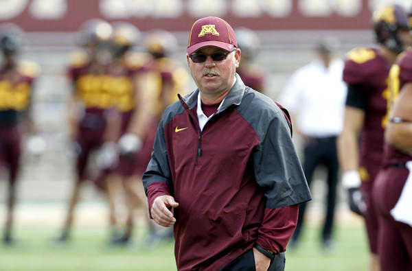 Minnesota Coach Jerry Kill watches his team warm up for a game against San Jose State earlier this season.