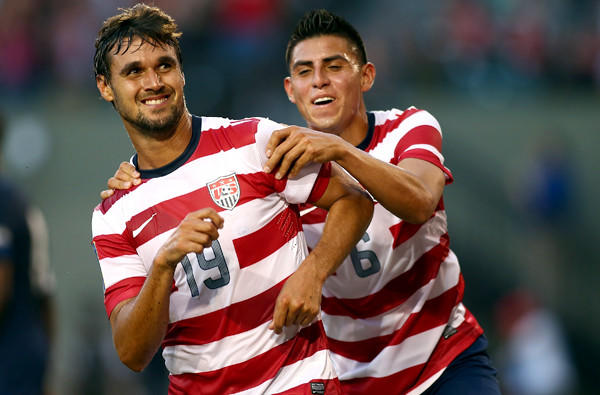 U.S. forward Chris Wondolowski celebrates with teammate Joe Corona after scoring his third goal against Belize during a CONCACAF Gold Cup game in Portland, Ore., earlier this year.