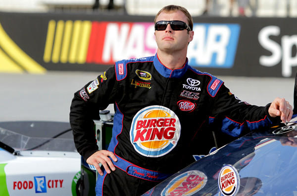 NASCAR driver Travis Kvapil watches from the grid during qualifying for the NASCAR Sprint Cup Series race at Bristol Motor Speedway in August.
