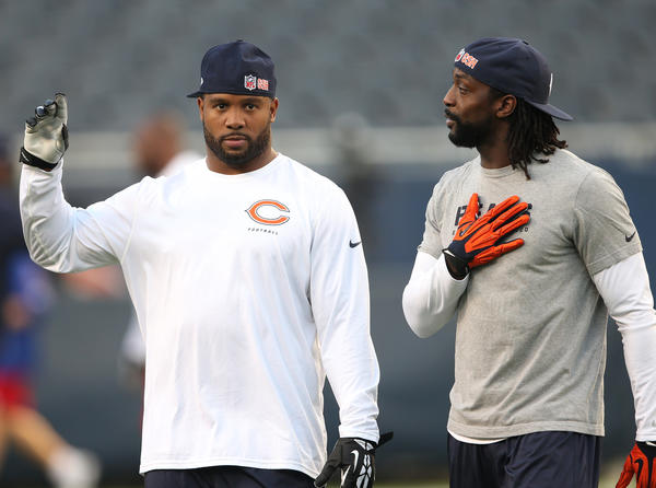 Lance Briggs (left) and Charles Tillman talk before Thursday's game.