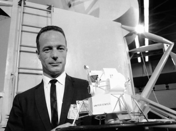 Astronaut Scott Carpenter poses with a model of the Lunar Excursion Module at the Grumman Aircraft Engineering Corp. plant in Bethpage, N.Y. Carpenter, the second American to orbit the Earth, died Thursday after a stroke. He was 88.