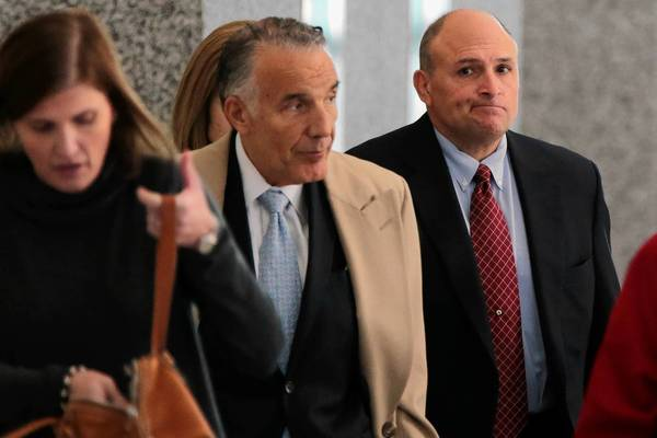 William Mastro, far right, owner of what was once a leading sports memorabilia and Americana business, leaves the Dirksen U.S. Courthouse on Thursday after pleading guilty to mail fraud.