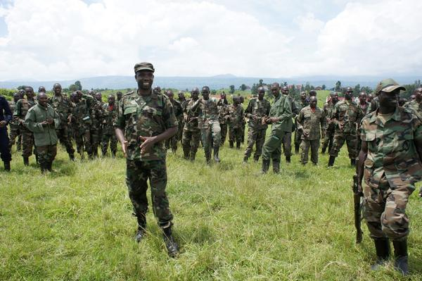 M23 rebels, with spokesman Vianney Kazarama in the left foreground, are pictured in April at the Rumangabo camp in the Democratic Republic of Congo. Peace talks between the rebels and the Congolese government have been suspended for months and an upsurge in fighting has occurred. A human rights group reported Thursday that M23 leaders have restored gold trafficking to finance their brutal rebellion.