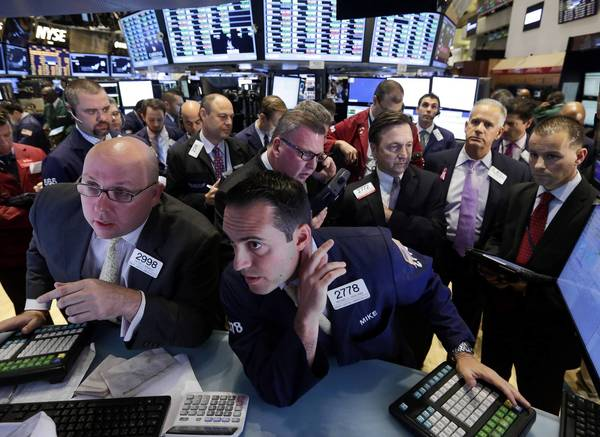 Traders work on the floor of the New York Stock Exchange, where stocks rose sharply on hopes that the budget impasse in Washington may break soon.