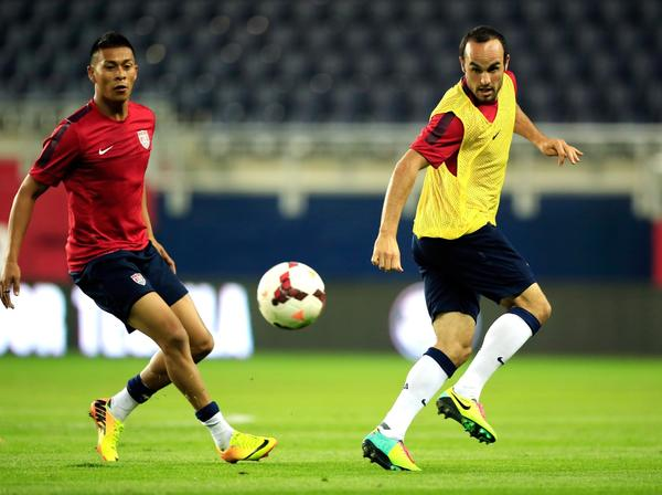 Michael Orozco Fiscal and Landon Donovan scrimmage during a U.S. men's national team practice at Sporting Park in Kansas on Thursday.