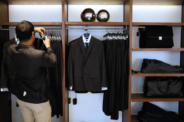 Apparel sales were particularly weak in September. Above, a customer shops for a new suit at a Banana Republic store in Los Angeles.
