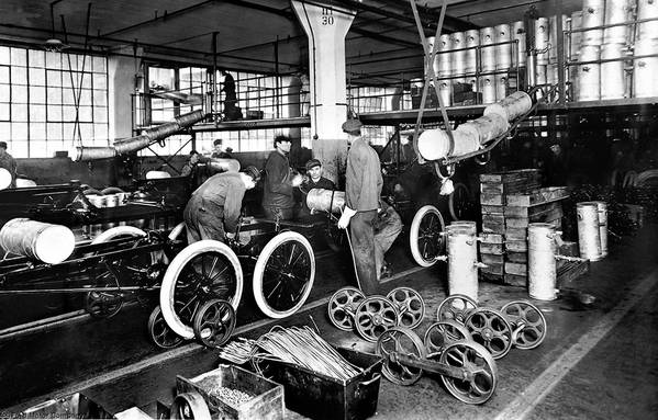 In 1914, Henry Ford more than doubled factory workers' minimum pay to $5 a day so they could afford to buy Ford cars. Above is the Highland Park plant in 1913.