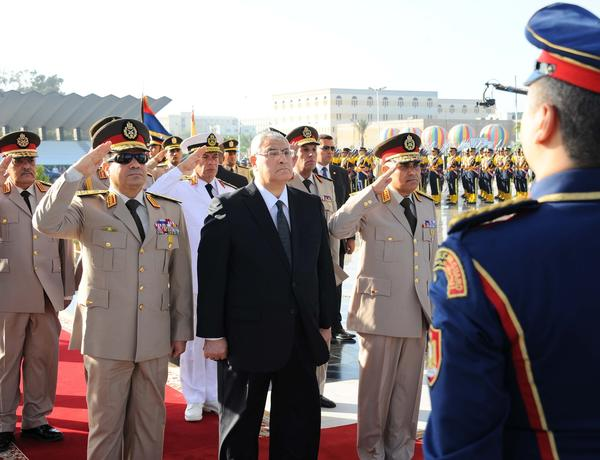 Egypt's interim president Adly Mansour, center, with Defense Minister Colonel General Abdul Fattah Sisi, left, and Chief of Staff Sedki Sobhi. ( October 6, 2013)