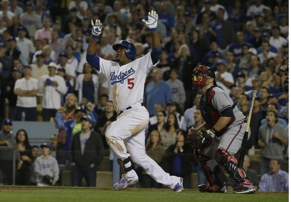 The Dodgers' Juan Uribe hits a two-run homer against the Braves.