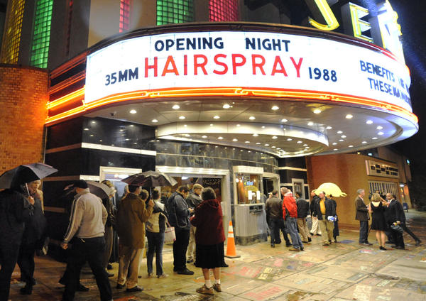 "A crowd gathers outside the Senator Theatrere on the night of the newly renovated theater's reopening Thursday, Oct. 10, 2013 in Baltimore. The historic movie house featured a showing of John Waters' ""Hairspray"" to mark the film's 25th anniversary."