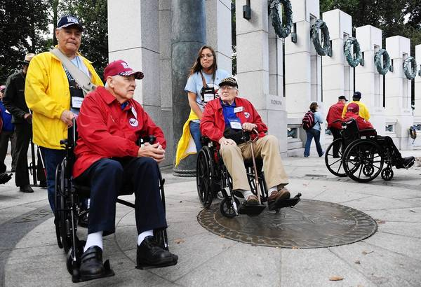 World War II veterans Alfredo Alvarez, left, and Robert Crawford visit the World War II Memorial in Washington.