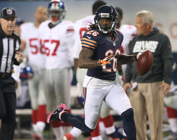 Bears corner back Tim Jennings (26) returns an interception for a touchdown in the first quarter.
