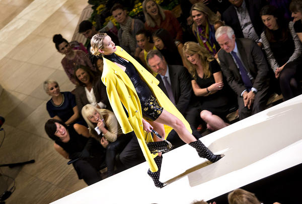 A model wears he latest fashions from Versace to the delight of the crowd during South Coast Plaza's Live the Look event.