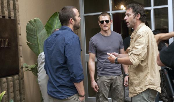 """Director Michael J. Bassett (right) talks to """"Strike Back"""" stars Sullivan Stapleton and Philip Winchester."""