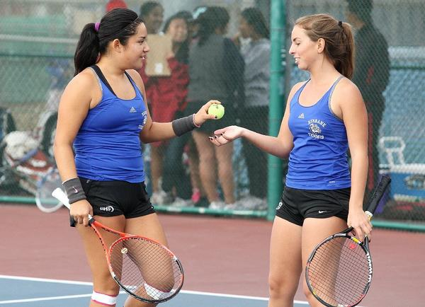 Burbank High's doubles team of Veronica Mendoza and Gabrielle Markari tied the Bulldogs' match versus Arcadia at 9 with a 7-5 victory in Pacific League play Thursday afternoon at Burbank High. The Apaches won, though, on games, 79-77. (Tim Berger/Staff Photographer)