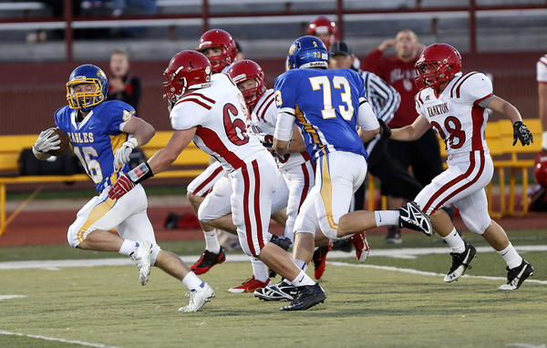 Aberdeen Centrals Mitch Johnson, left, tries to outrun earlier this season the pursuit of a group of Yankton defenders including Tim Cross, who is reaching for Johnson. In on the play for Central is Lincoln Flakus (73).