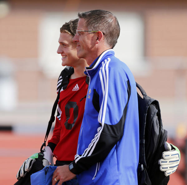 Groton goal keeper Chance Strom, left, poses for a photograph with Aberdeen Central boys coach Steve Cogley, before the start of their game Thursday at the State Soccer Tournament.