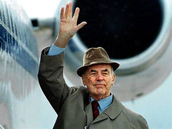 File photo of former German Nazi SS officer Erich Priebke waving to the members of the media as he boards a plane to be extradited to Italy to face a war crimes trial.