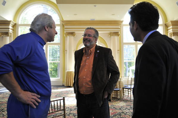 CCSU Men's Basketball Coach Howie Dickenman, Dr. William Petit and Hartford attorney Eric Daniels talk before an Interval House press conference in Simsbury Friday morning.