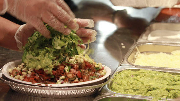 Finishing touches are put on a Burrito Bowl at Chicago Chipotle in a 2011 file photo.