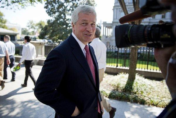 Why is this man smiling? The not-embattled JPMorgan chairman and CEO Jamie Dimon leaves a meeting with President Obama over the budget standoff last week.