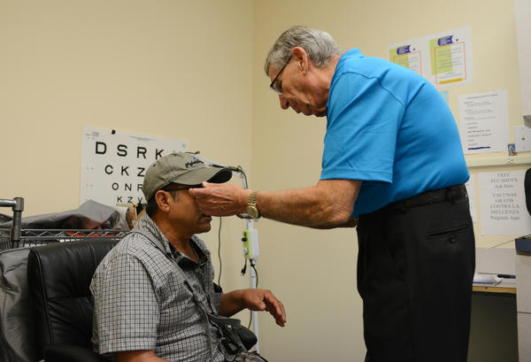 Dr. Jerry Leifer fits Angel Martinez with new glasses at the Caridad Center in Boynton Beach.