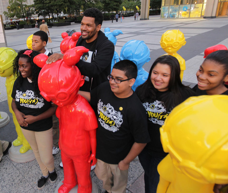 Chicago artist Hebru Brantley (center) and the children who posed for his sculpture at Pioneer Court will visit the sculpture so the kids can see themselves.