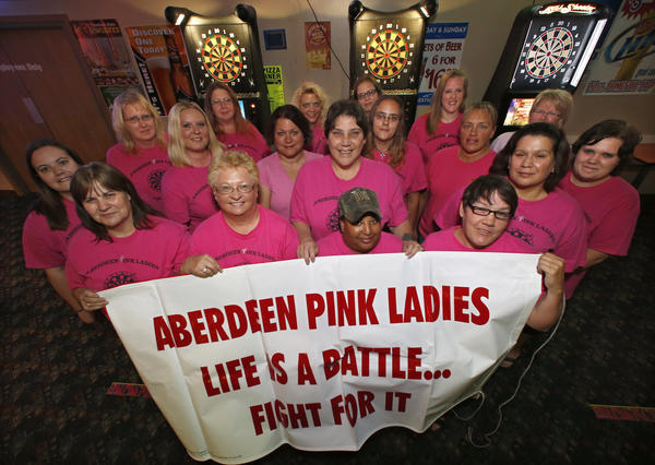 Members of the Aberdeen Pink Ladies, holding the banner from the left are: Rosemary Moffenbier, June Jorgenson, Annie Bebbo and Janelle Henman. From the left around are: Justine Harty, Tammy Erickson, Lisa Sudlow, Bekah LeFort, Jen Danielson, Liza Thomas-Wade, Theresa Norton, Sharee Burgess, Christy Arneson, Shana Kopecky, Tanya Glodrey, Brenda Christensen, Andy Fields and Miranda Erickson.