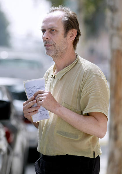Gothrocker Peter Murphy holds paperwork as he comes out of the Glendale jail on Tuesday, March 19, 2013. The Bauhaus band lead singer spent the weekend in Jail after crashing his car into another one in Glendale on Saturday.
