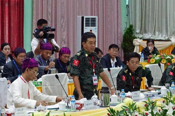 Gen. Gwan Maw, center, of the Kachin Independence Army, speaks at a meeting with representatives of the Myanmar government on Tuesday.