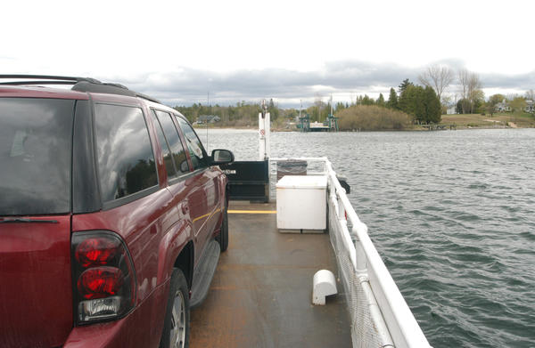 The Ironton Ferry can transport four vehicles at once across the narrows at the mouth of Lake Charlevoix's South Arm.