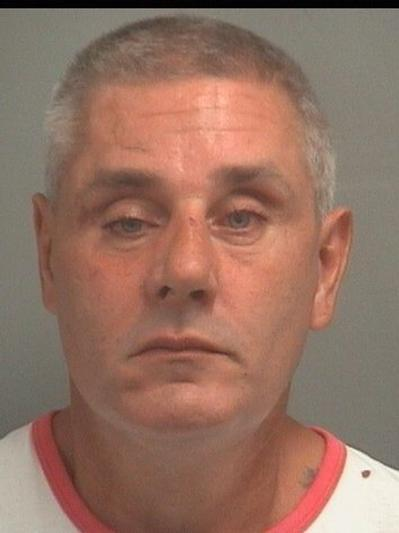 George Paris, 45, of West Boca, was arrested on Oct. 10, 2013. He is charged with two counts of tampering with a witness.