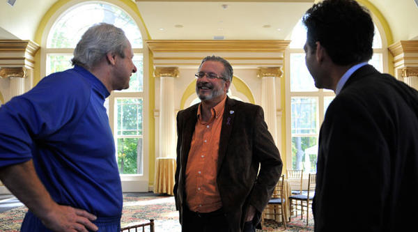 CCSU Men's Basketball Coach Howie Dickenman, Dr. William Petit and Hartford attorney Eric Daniels talk before an Interval House press conference in Simsbury Friday.