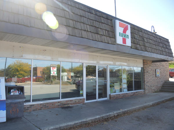 The former 7-Eleven store in Charlevoix is emptied of merchandise and shuttered.