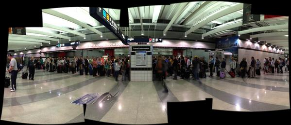 Two days before the Chicago Marathon is typically one of the O'Hare Blue Line station's busiest days. This is a composite image.