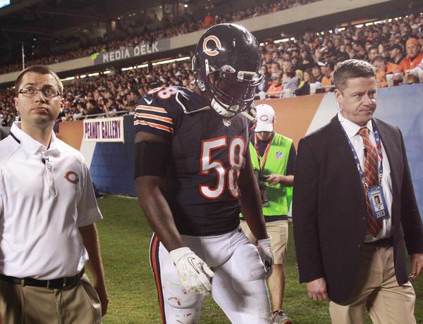 Chicago Bears middle linebacker D.J. Williams leaves the game Thursday night.