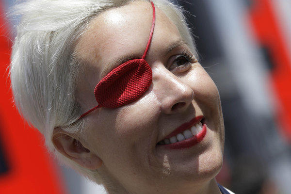 Former Formula One test driver Maria de Villota smiles in the paddock at the Catalunya track in Montmelo, Spain.