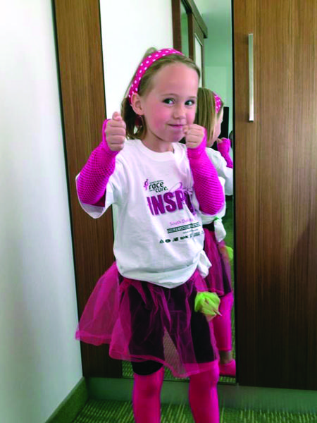 "Kaylee Littler's Nana outfitted her for the Susan G. Komen Race to End Cancer. It even came with a wand that Kaylee said she waved to ""wish the cancer away."""