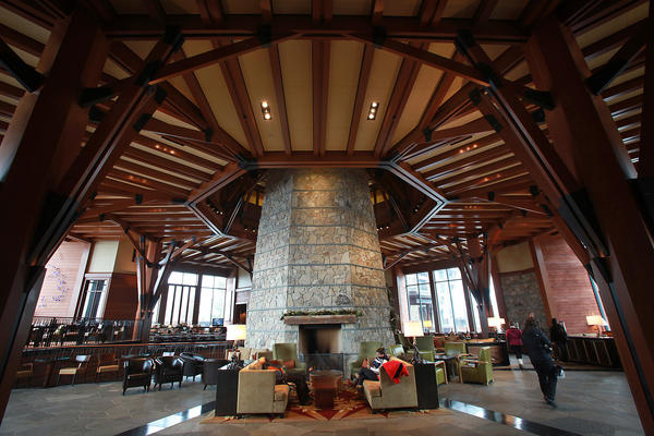 Cozy seating areas surround the stone fireplace column at the Ritz-Carlton at Northstar.