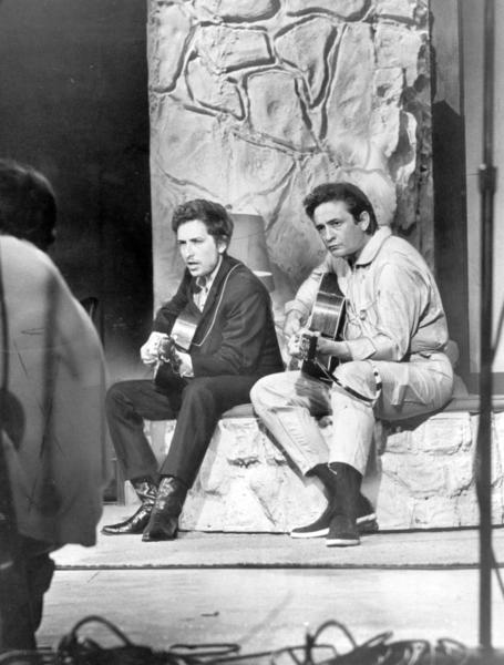 "In 1969, Johnny Cash debuted ""The Johnny Cash Show"" on ABC. This picture depicts him performing with Bob Dylan during the premiere. Cash's friendship with Dylan deepened through the years, and the pair worked on a handful of collaborations together."
