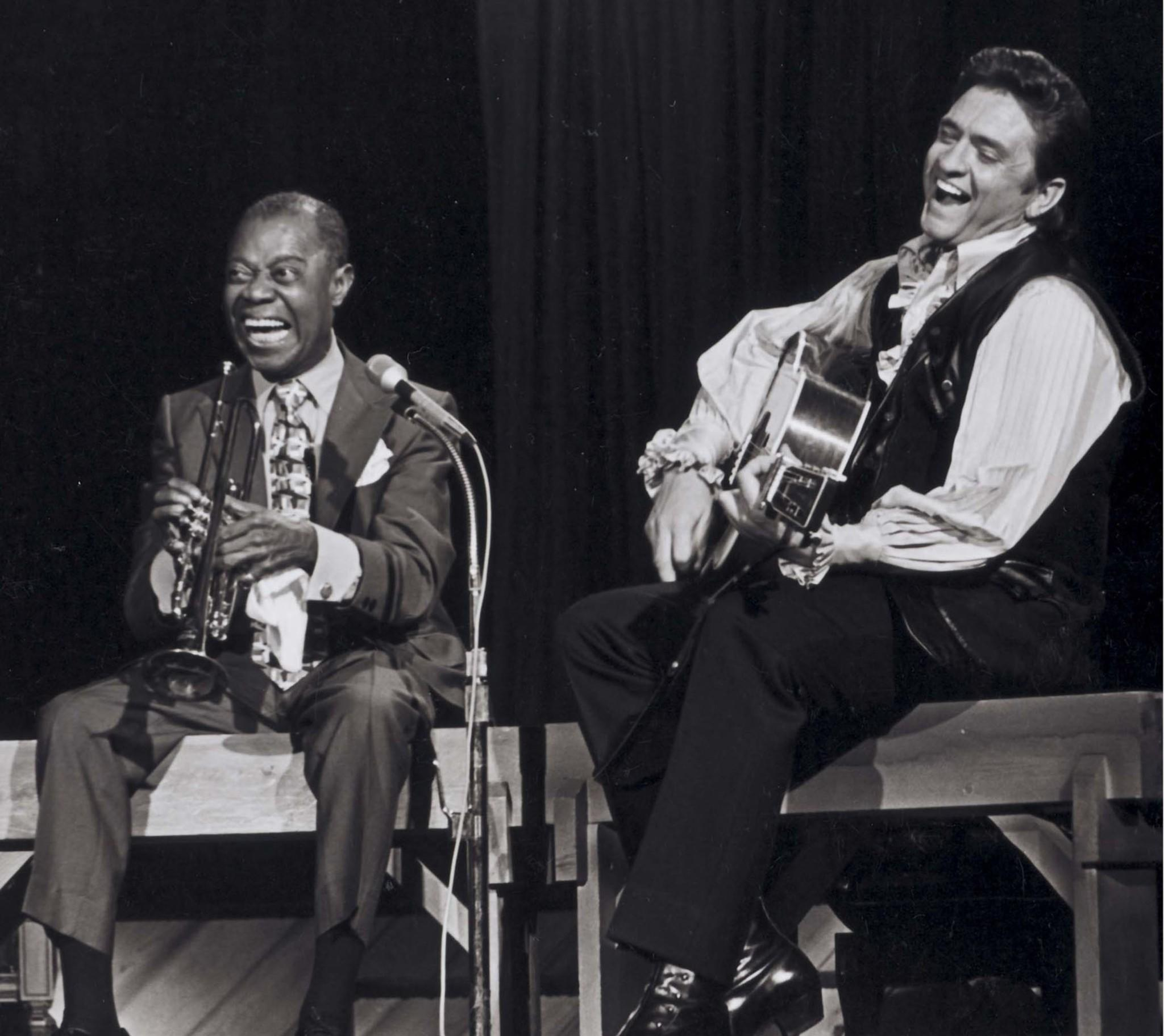 Johnny Cash, shown performing with Louis Armstrong, was known for championing social causes. (Les Leverett / Columbia Legacy)
