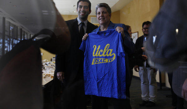 Internal Vice President of the Undergraduate Student Assn. Council Avi Oved, left, presents a UCLA T-shirt to University of California's President Janet Napolitano on Friday.