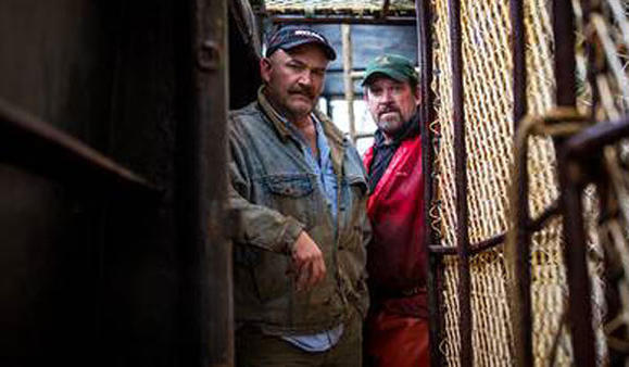 Captain Keith Colburn, left, and Relief Captain Monte Colburn on their boat, Wizard for 'Deadliest Catch'